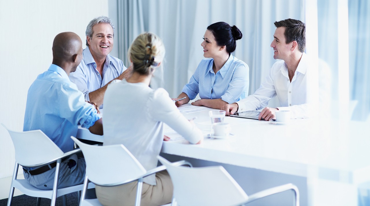 Diverse group of businesspeople having a brainstorming session in an office, group, meeting, conference