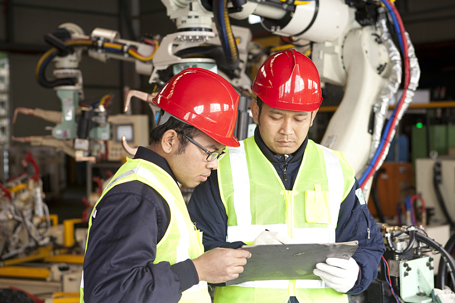Two manufacture worker discussing in factory; Shutterstock ID 174605396; PO: 123