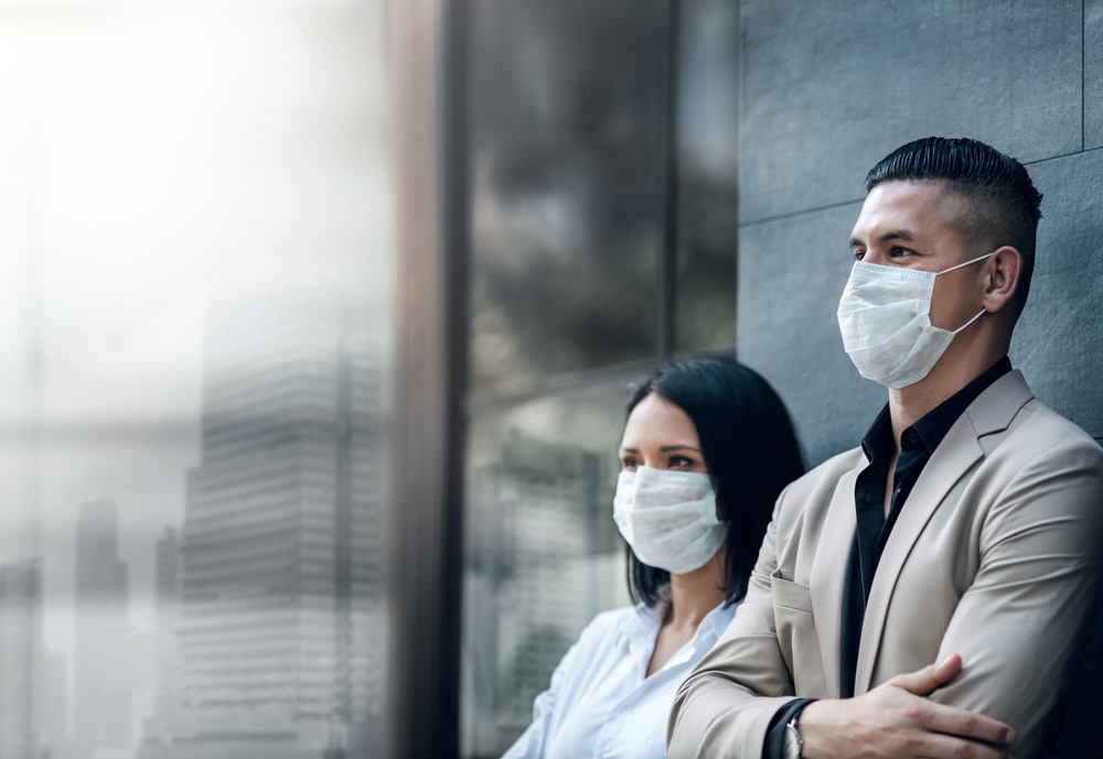 Covid-19 or Corona Virus Situation in Business Concept. Business People with Surgical Safety Mask standing at Office Urban Building. Team Employees or Owner Protected and take Care of their Health; Shutterstock ID 1681142671; Other: ; Purchase Order: 123; Client/Licensee: ; Job: